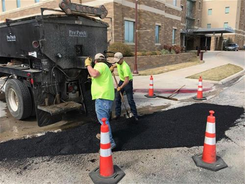 Street workers working the Hotmix near Founders Hall