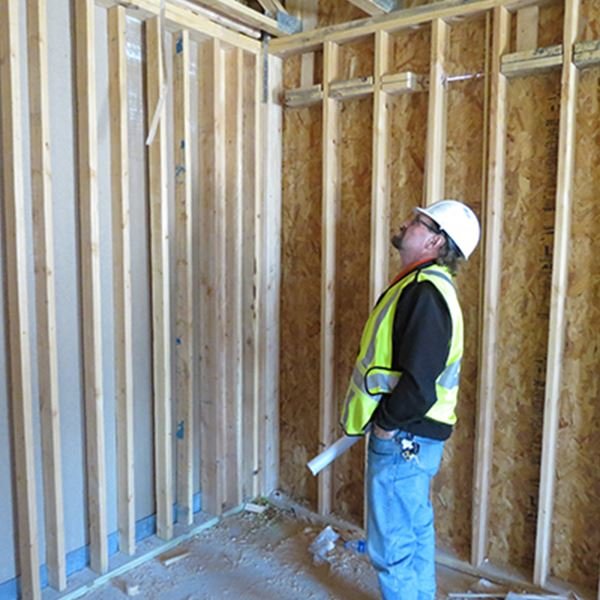A contracter looking at an interior structure of a house being develped